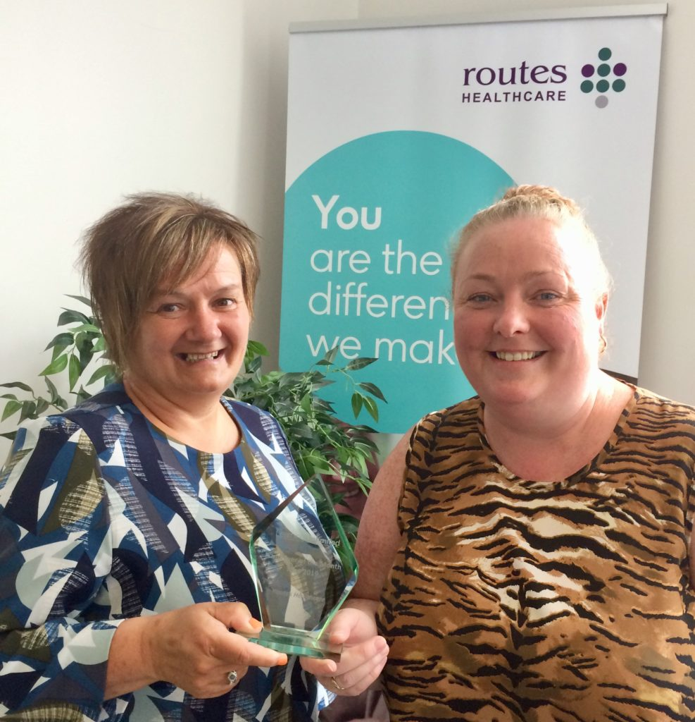 Learning Unlimited's Carole Sydenham presents Sarah Mooney of Routes Healthcare with the Employer of the Month award.